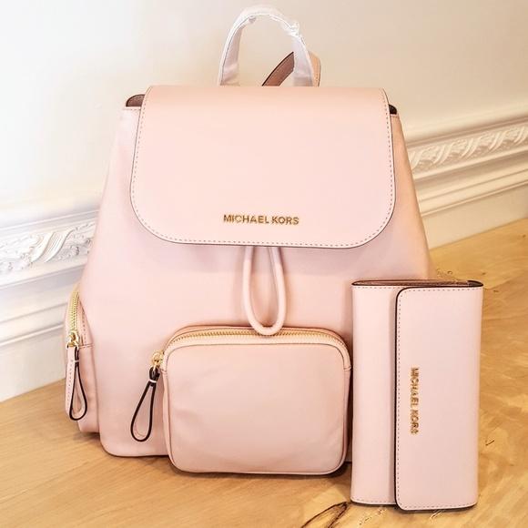 Michael Kors Handbags - NWT Michael Kors Backpack & Wallet